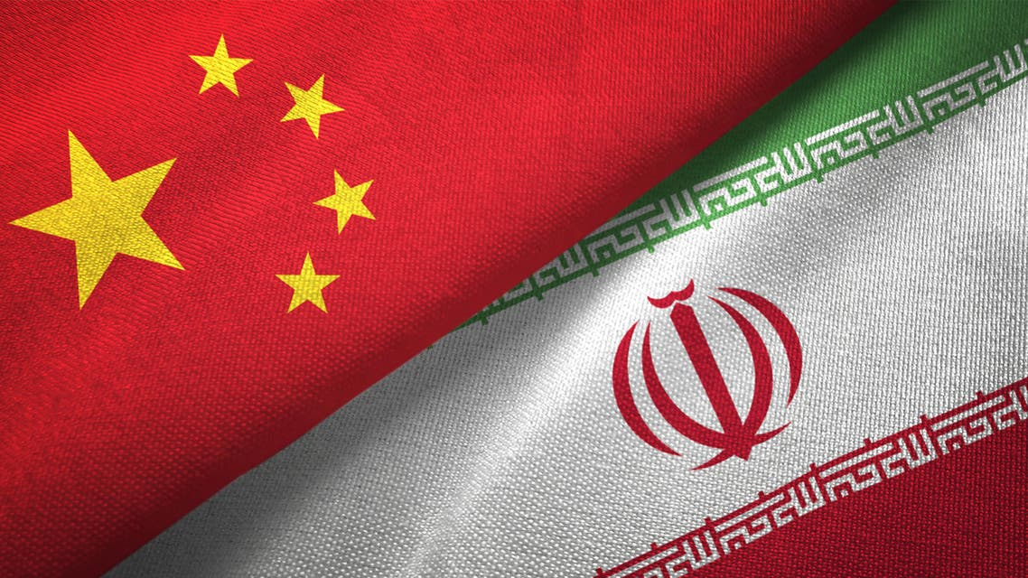 Iran and China two flags together realations textile cloth fabric texture stock photo