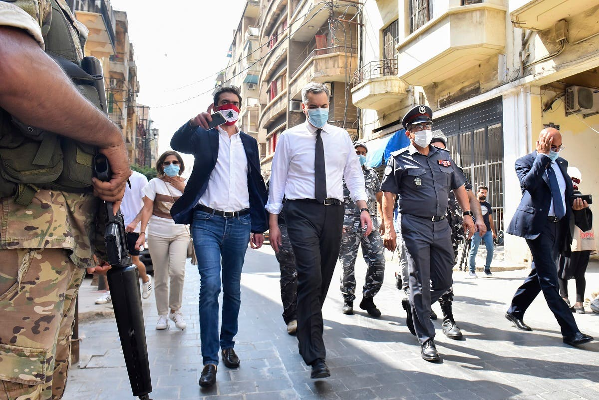 Lebanon's newly-appointed Prime Minister Mustapha Adib (C) visits Beirut's badly-hit Gemmayzeh neighbourhood, on August 31, 2020. (AFP)