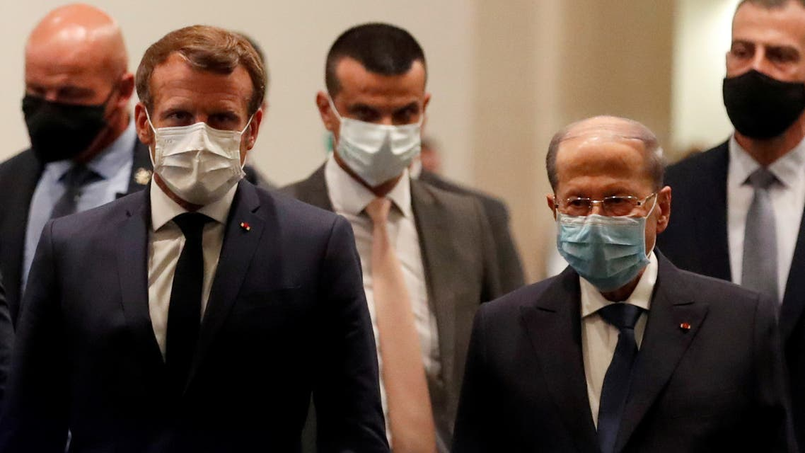 French President Emmanuel Macron and Lebanese President Michel Aoun leave after their meeting at Beirut International airport, Lebanon August 31, 2020. REUTERS/Gonzalo Fuentes/Pool