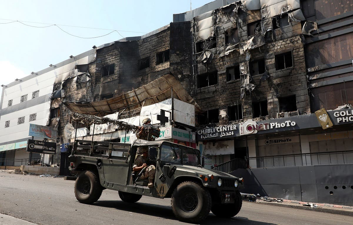 Lebanese army soldiers patrol near burnt shops in the aftermath of clashes in Khaldeh, Lebanon August 28, 2020. (Reuters)