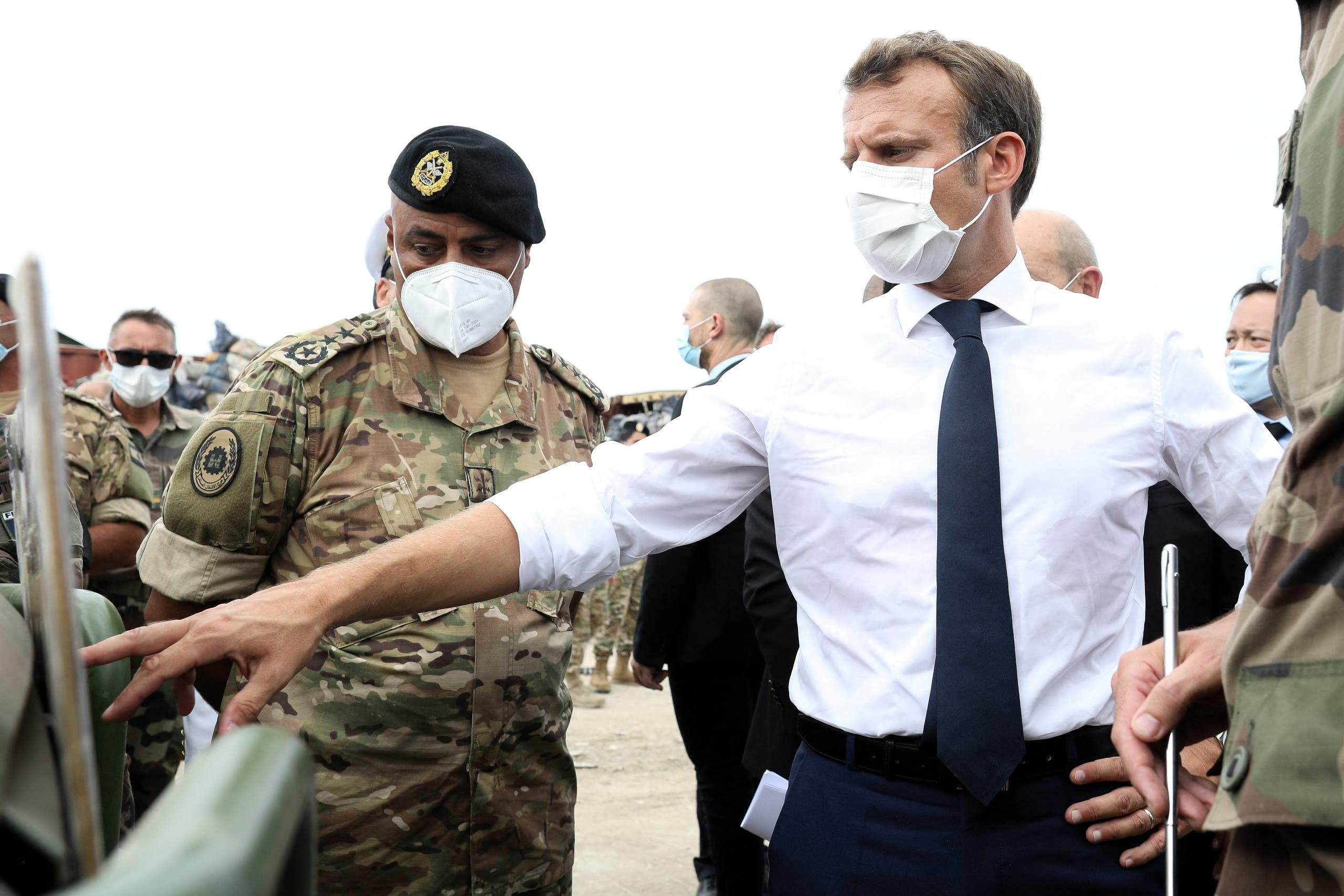 French President Emmanuel Macron meets members of the military mobilised for the reconstruction of the port of Beirut, in Beirut, Lebanon September 1, 2020. (Reuters)