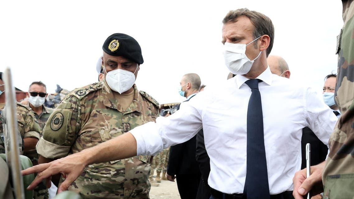 French President Emmanuel Macron meets members of the military mobilised for the reconstruction of the port of Beirut, in Beirut, Lebanon September 1, 2020. Stephane Lemouton/Pool via REUTERS