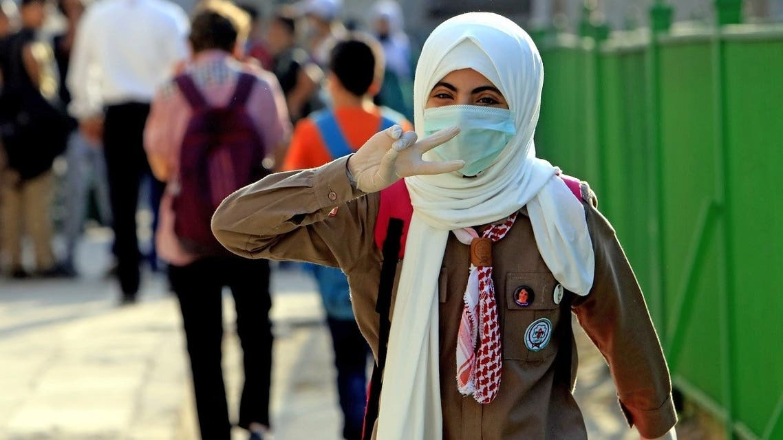 A student attends the first day of school while wearing a protective mask and gloves in the Jordanian capital Amman amid the ongoing COVID-19 pandemic, on September 1, 2020. (AFP)