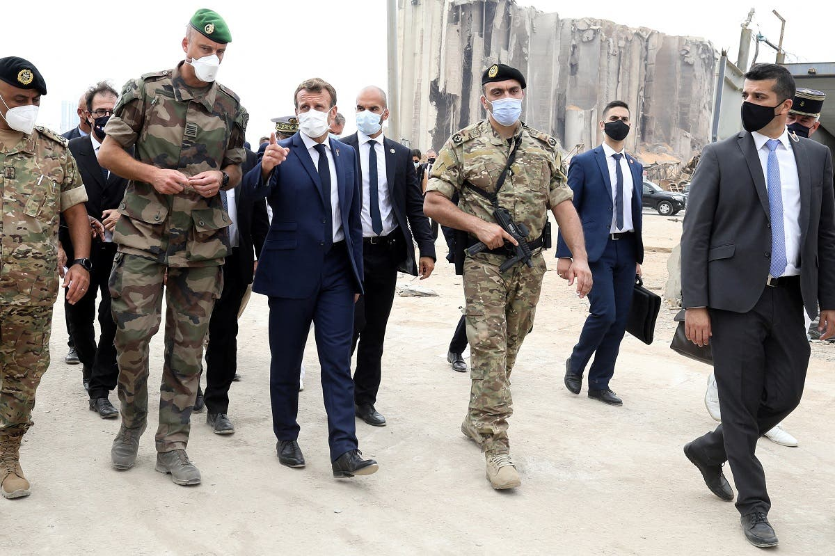 French President Emmanuel Macron meets members of the military mobilized for the reconstruction of the port of Beirut, in Beirut, Lebanon September 1, 2020. (Reuters)