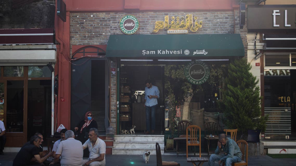 People sit outside a cafe in the Turkish capital Istanbul's Little Damascus neighborhood. (Nicholas Frakes)