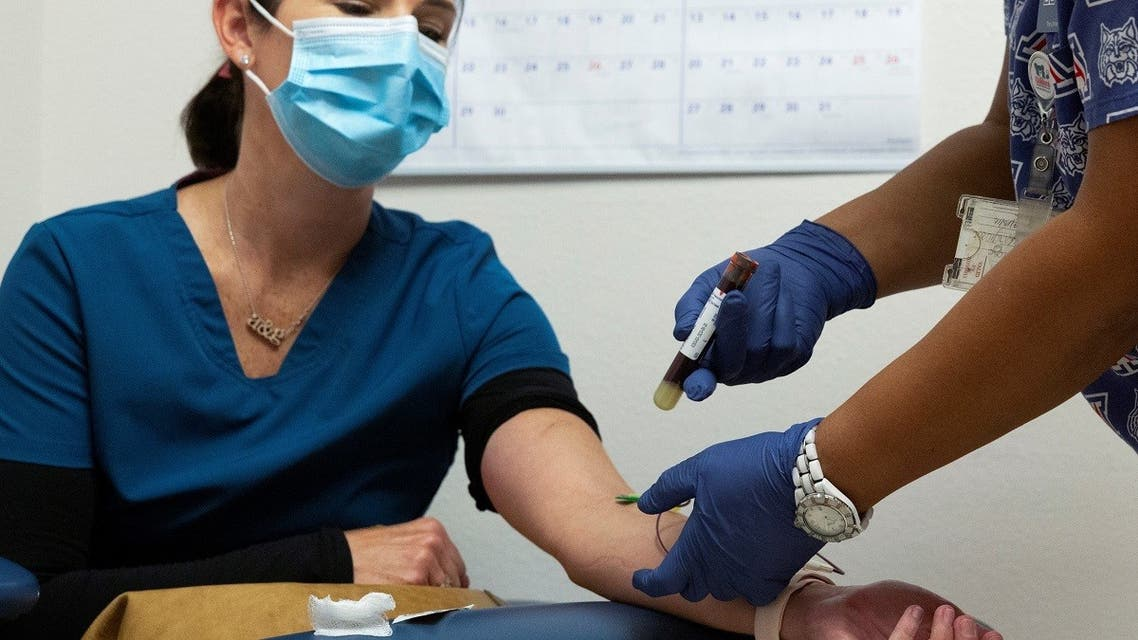 A file photo shows a blood sample is articulated after being taken from an employee of Oro Valley Hospital, for an antibody test for the coronavirus disease at the University of Arizona in Tucson, Arizona, US, July 10, 2020. (Reuters)