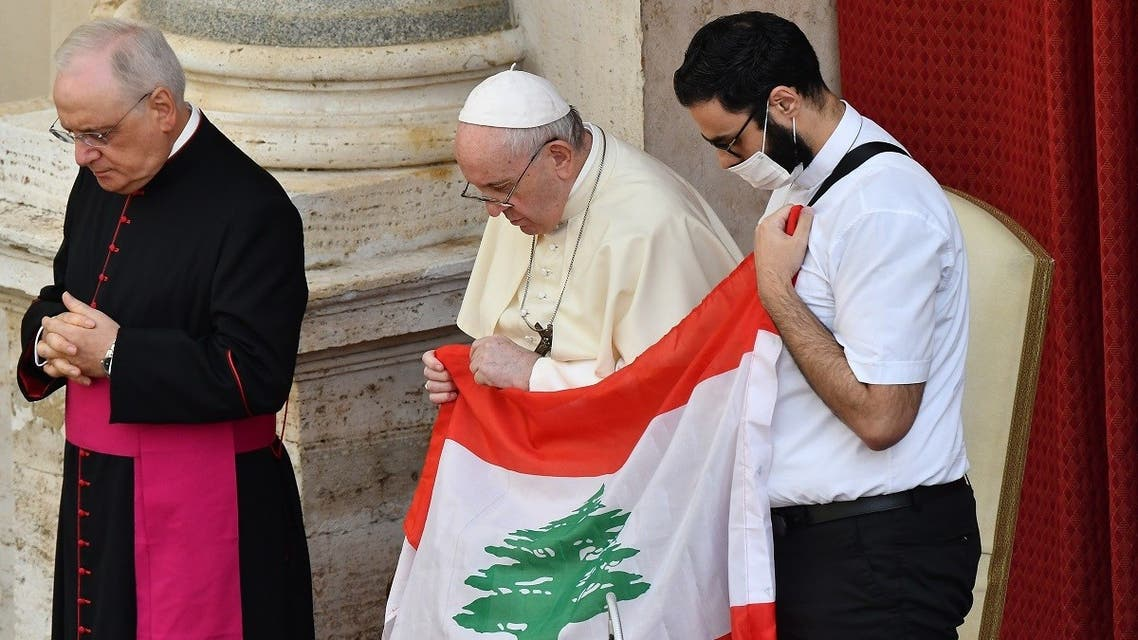 (From L)Monsignor Leonardo Sapienza, Pope Francis and a Lebanese priest holding Lebanon's flag pray for Lebanon during the Pope's limited public audience at the San Damaso courtyard in The Vatican on September 2, 2020. (AFP)