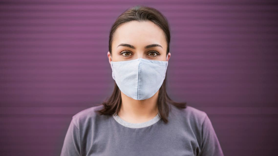 Beautiful girl with medical mask to protect her from virus. Corona virus pandemic stock photo