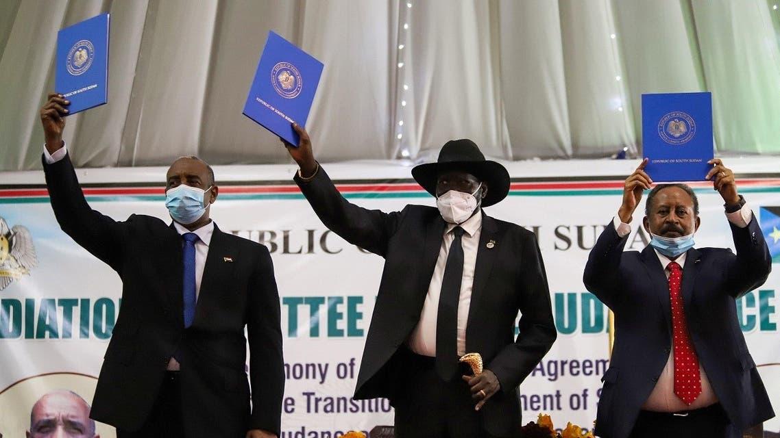 Sudan's Sovereign Council Chief General Abdel Fattah al-Burhan, South Sudan's President Salva Kiir, and Sudan's PM Abdalla Hamdok lift copies of the peace deal in Juba, South Sudan August 31, 2020. (Reuters)
