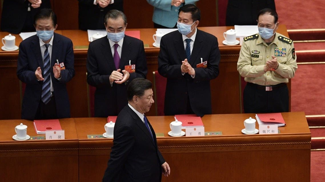China's President Xi Jinping is applauded by, from left, State Councilor Xiao Jie, FM Wang Yi, State Councilor Wang Yong, and Defense Minister Wei Fenghe at the Great Hall of the People in Beijing, May 28, 2020. (AFP)