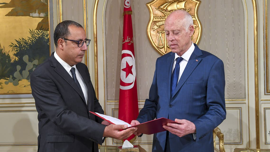 This handout image released by the Tunisian Presidency shows Tunisia's Prime Minister-designate Hichem Mechichi (L) presenting his cabinet list for Tunisian President Kais Saied (R) in Carthage palace , east of the capital Tunis, on August 24, 2020. Tunisia's prime minister-designate on Tuesday unveiled the country's second government in six months, which must now seek approval from lawmakers incensed by how the administration was formed.
