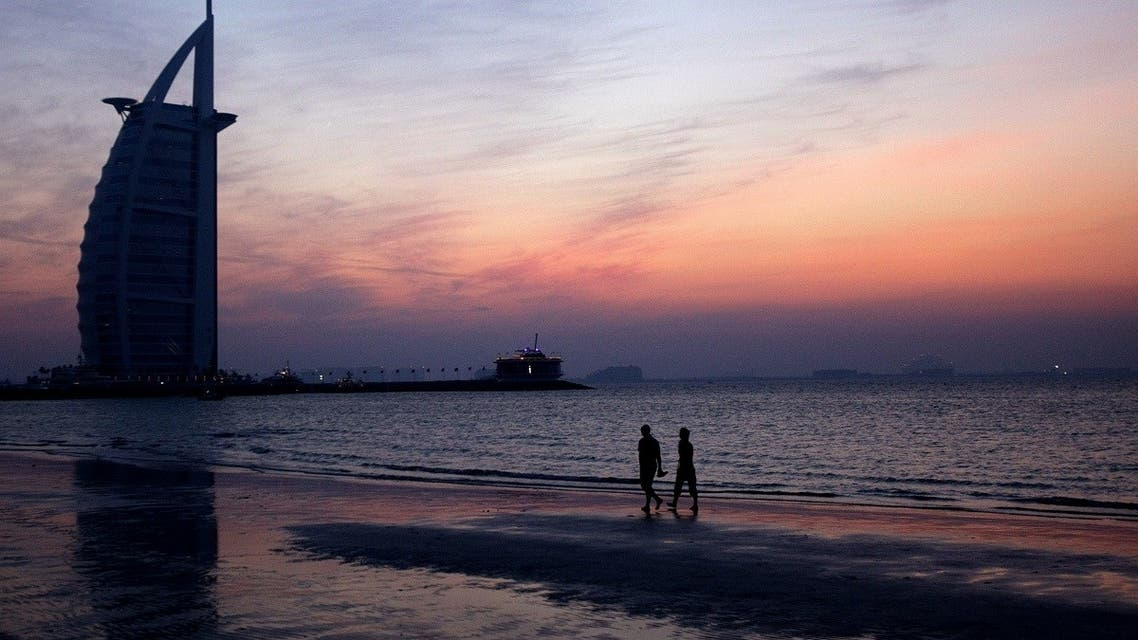 File picture dated November 18, 2009 shows a couple strolling during sunset along Jumeirah beach near the Burj al-Arab Hotel. (AFP)