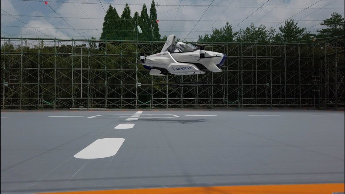 This handout picture taken in August 2020 obtained on September 2, 2020 from shows the SD-03 manned flying car during a test flight at Toyota test field in Toyota city, Aichi prefecture. (AFP/SkyDrive / CARTIVATOR)