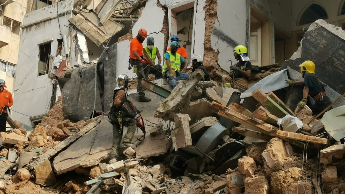 A rescue team searches the rubble in Beirut's Mar Mikhael area. (Twitter)