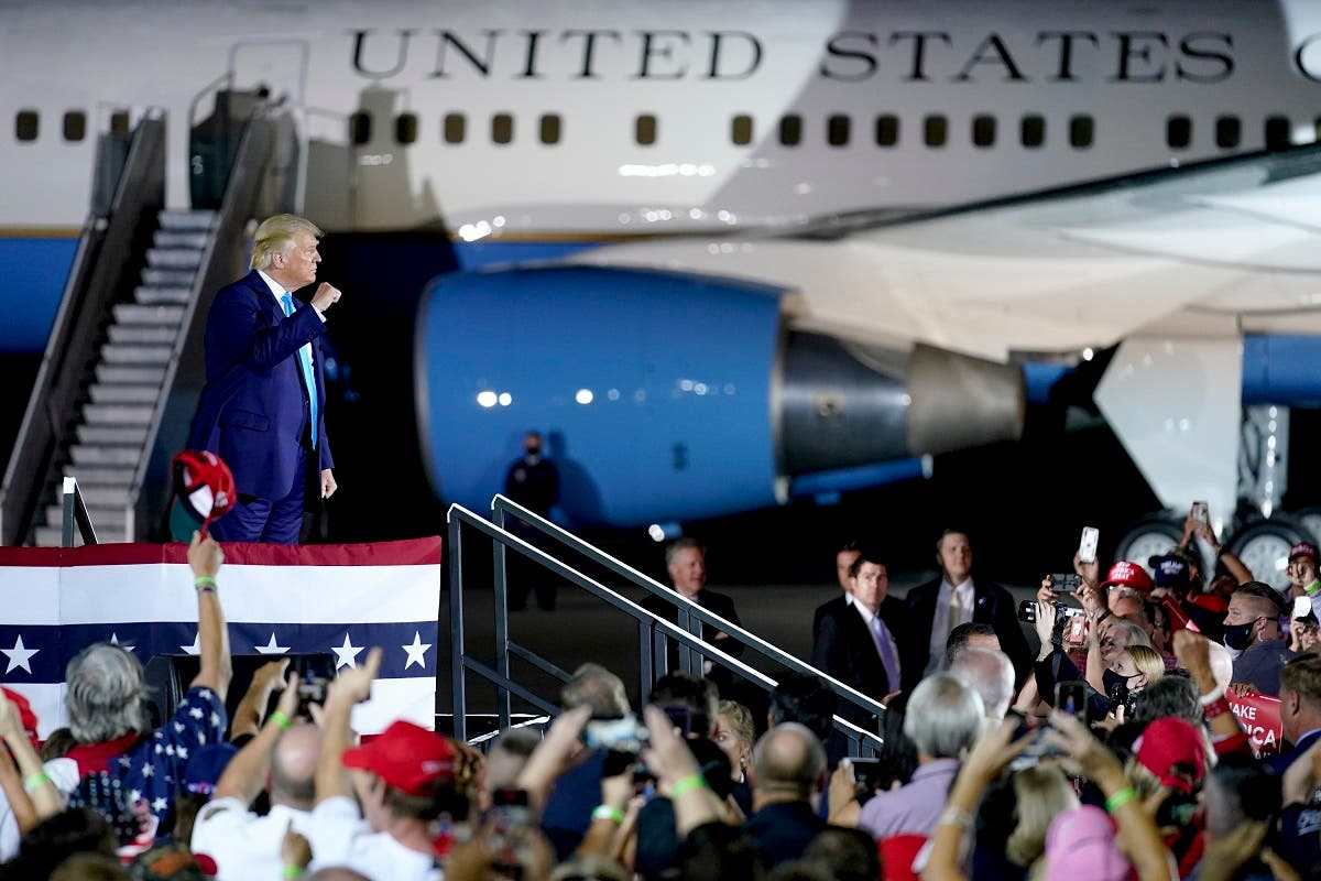 President Trump cheers with a crowd at a campaign event at the Arnold Palmer Regional Airport, in Latrobe, Pennsylvania. (AP)