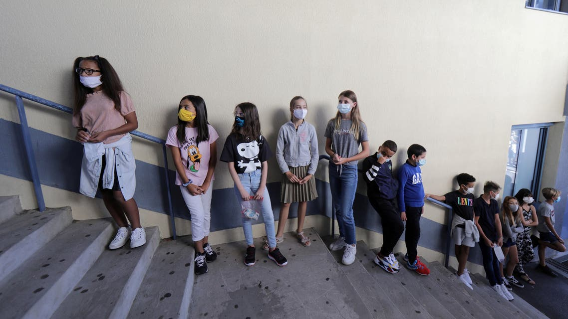 Secondary school students, wearing protective face masks, line-up to enter in the school canteen room at the College Henri Matisse school during its reopening in Nice as French children return to their schools after the summer break. September 1, 2020. (Reuters)