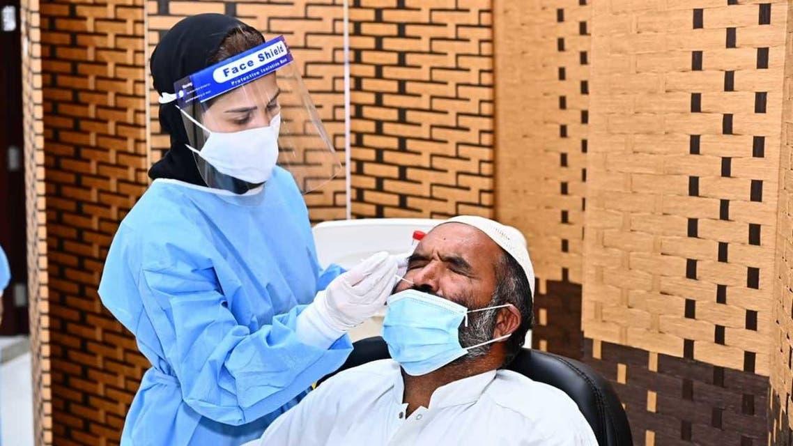 A female nurse conducts a COVID-19 test on a man in Fujairah, September 3, 2020. (WAM)
