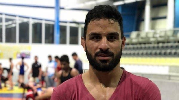 أم المصارع الإيراني مفجوعة: قتلوا بريئاً!