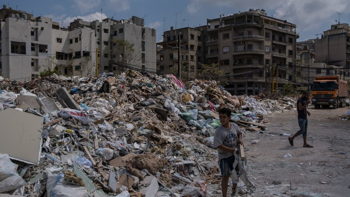 People sort through glass and rubble from the August 4 explosion on 26 August 2020 in Beirut, Lebanon. (Reuters)