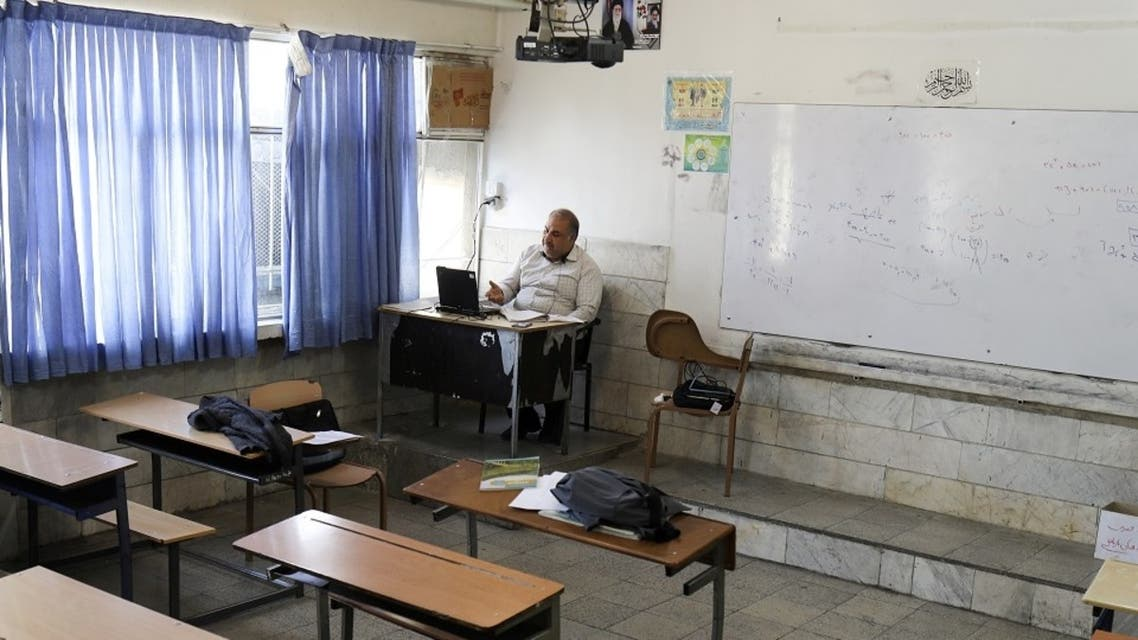A teacher is seen while teaching online school classes in Iran. (Reuters)