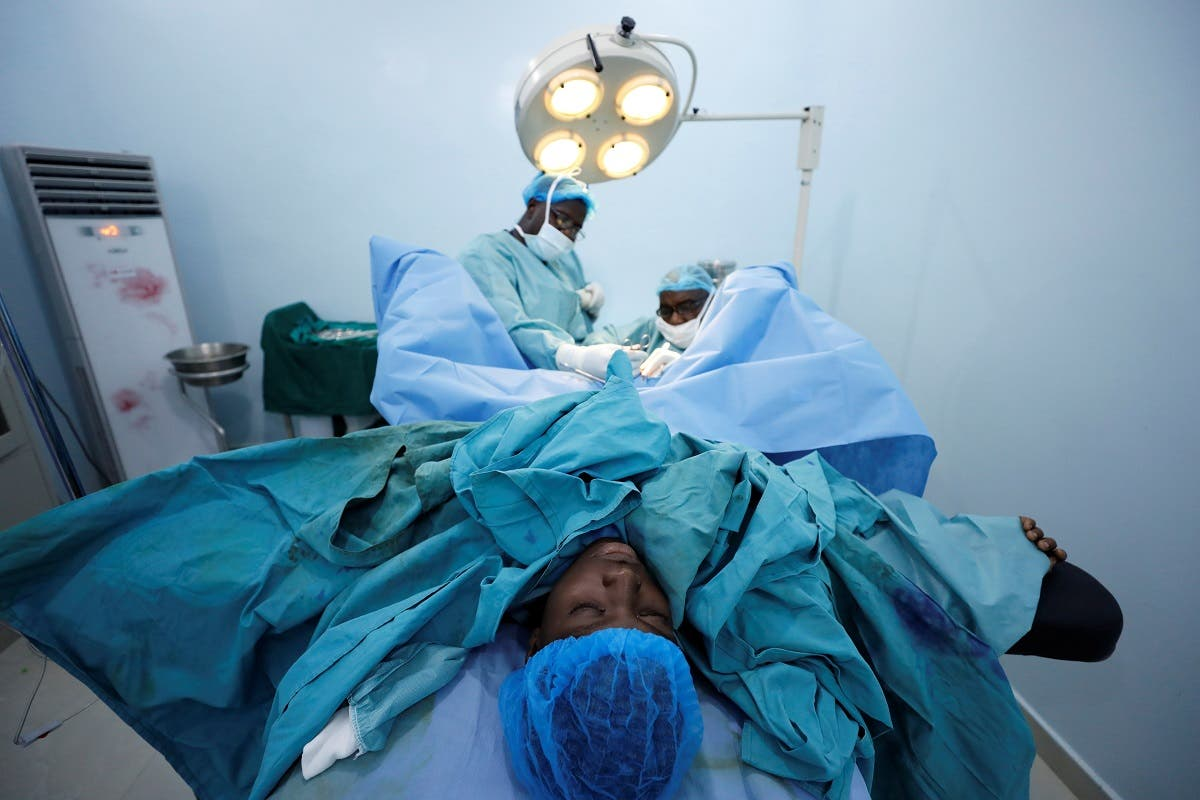As a pediatric surgeon Hennessey has worn an identical surgical facemask at work for the past 20 years, but says he wishes the development of transparent masks had happened sooner. (Reuters)