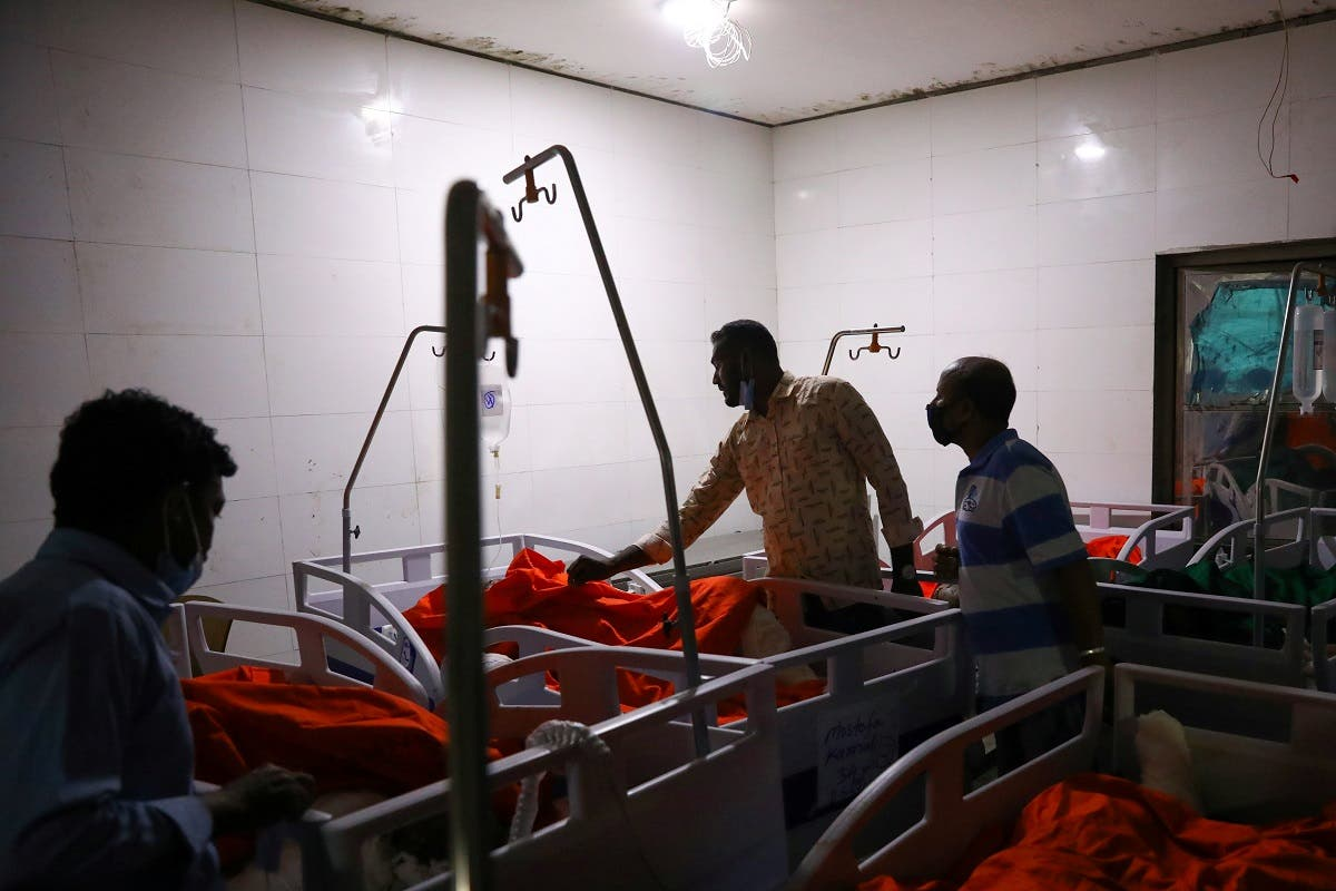 Relatives of victims try to identify their bodies at a hospital, after a gas pipeline blast at a mosque in Narayanganj, near Dhaka, Bangladesh, September 5, 2020. (Reuters)