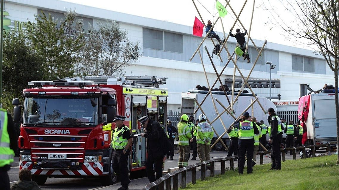 Police and fire services at the scene, outside Broxbourne newsprinters as protesters continue to block the road, in Broxbourne, Hertfordshire, England, Sept. 5, 2020. (AP)
