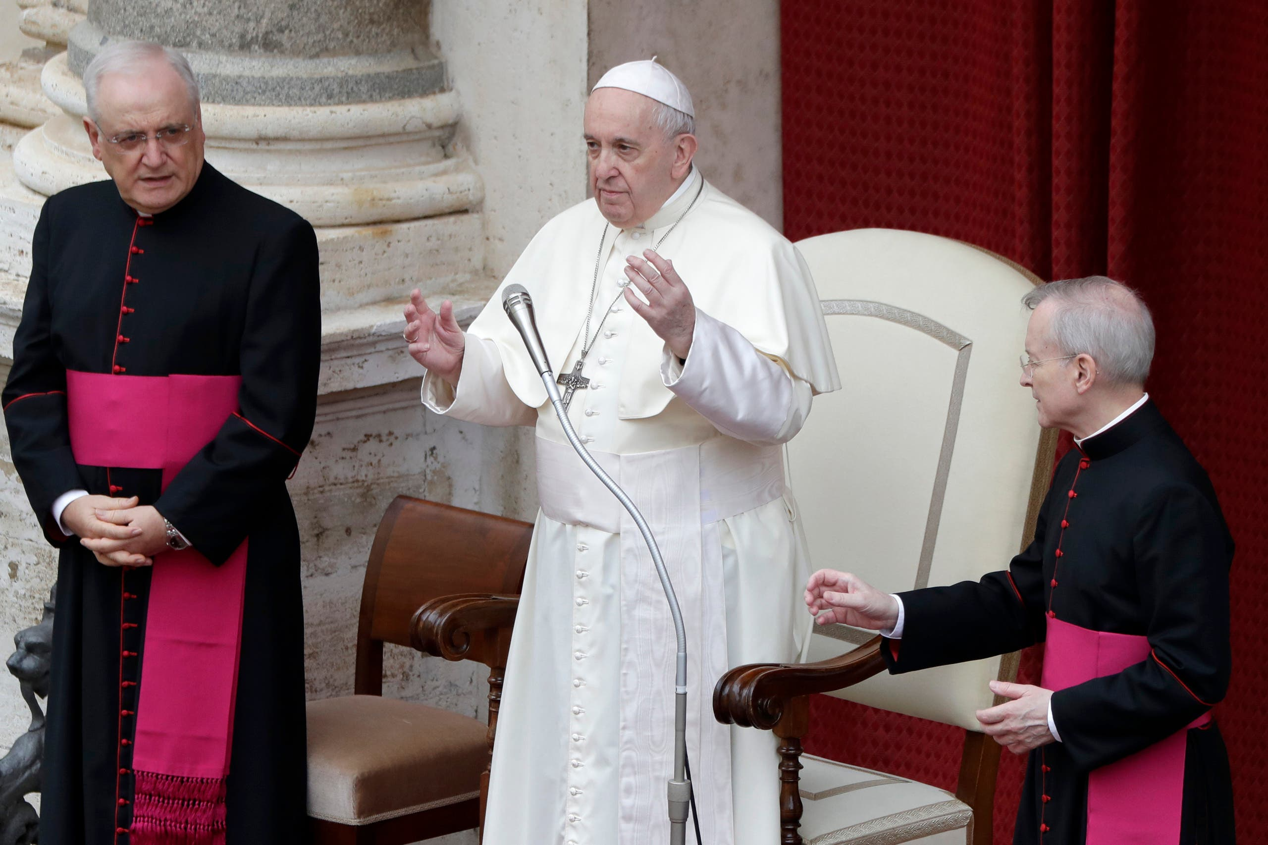 Pope Francis, center, delivers his message during his general audience, the first with faithful since February when the coronavirus outbreak broke out, at the San Damaso courtyard, at the Vatican, Wednesday, Sept. 2, 2020. (AP)