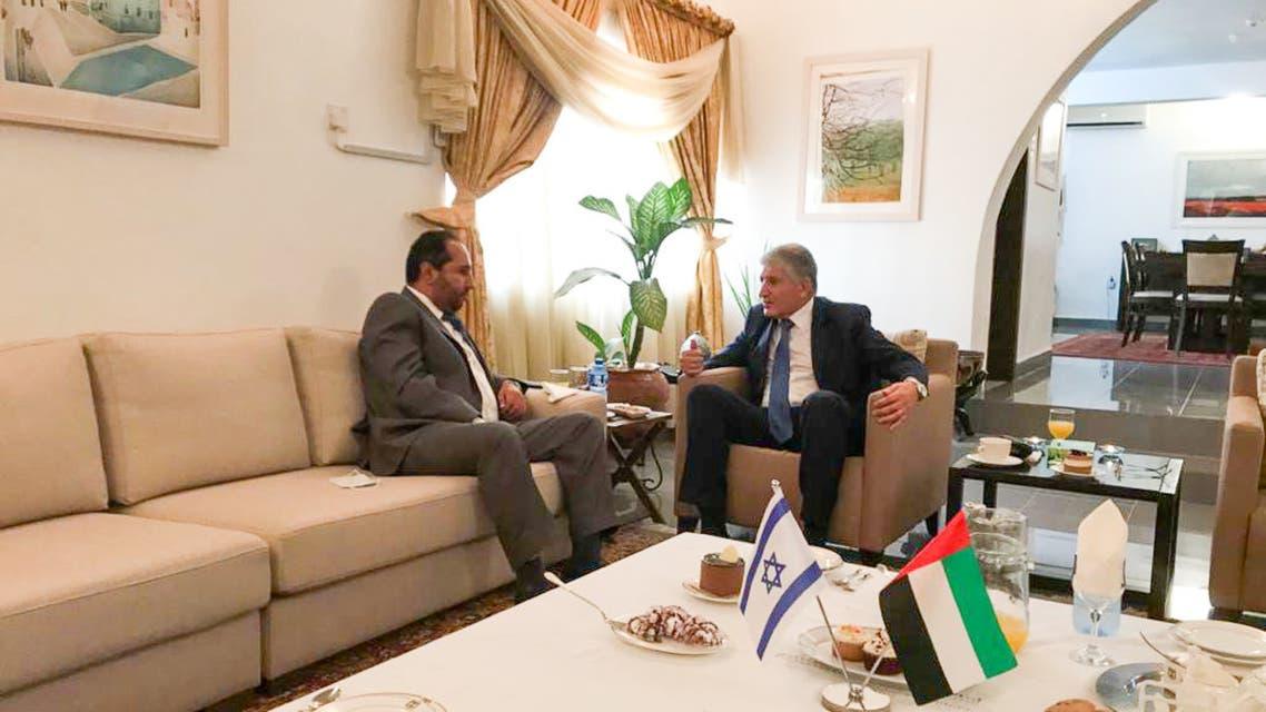 UAE official Khalifa Al Mehrizi, left, with Israeli official Shimon Ben-Shoshan, right, in Nigeria. (Twitter)
