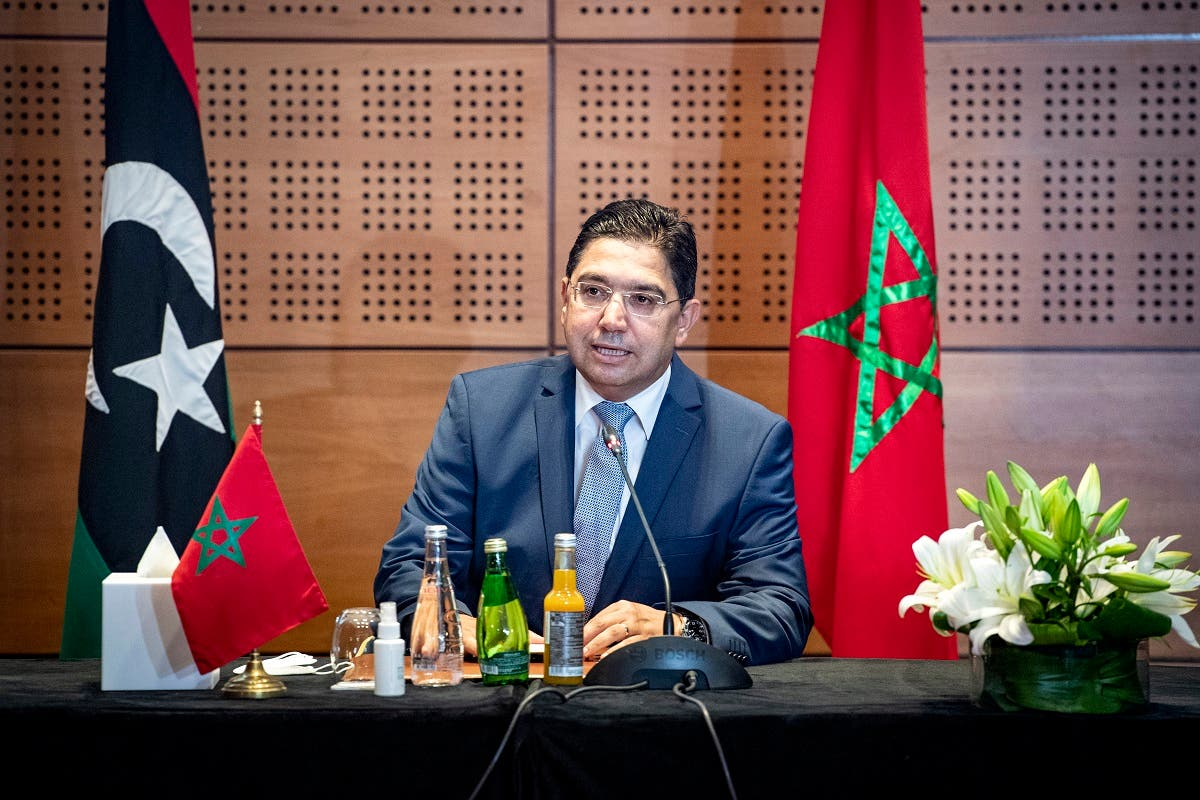 Nasser Bourita, Morocco's Minister of Foreign Affairs and International Cooperation, chairs a meeting of representatives of Libya's rival administrations in the coastal town of Bouznika, south of Rabat, on September 6, 2020. (AFP)