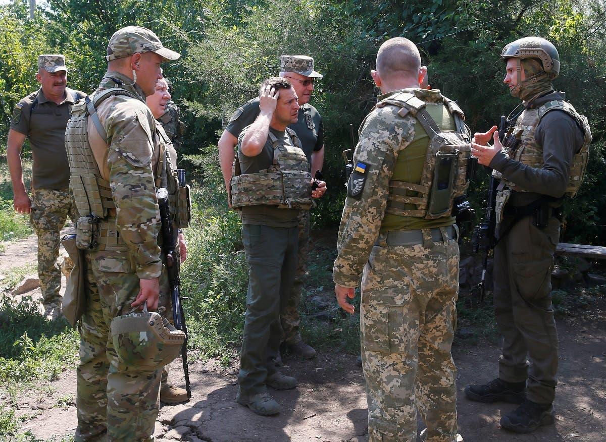 Ukraine's President Volodymyr Zelenskiy speaks to servicemen near the frontline with Russian-backed separatists in Krasnohorivka in Donetsk Region, Ukraine August 7, 2020. (Reuters)