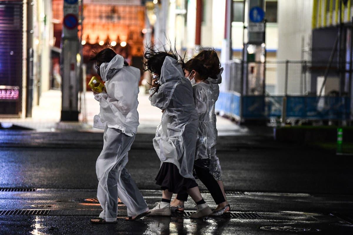 Women walk in heavy rain as Typhoon Haishen hits Kagoshima, Kagoshima prefecture on September 6, 2020. (AFP)