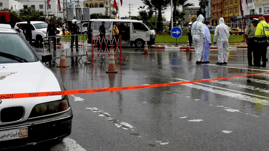 Tunisian forensic police investigate the site of an attack on Tunisian National Guard officers on September 6, 2020, in Sousse, south of the capital Tunis. (AFP)