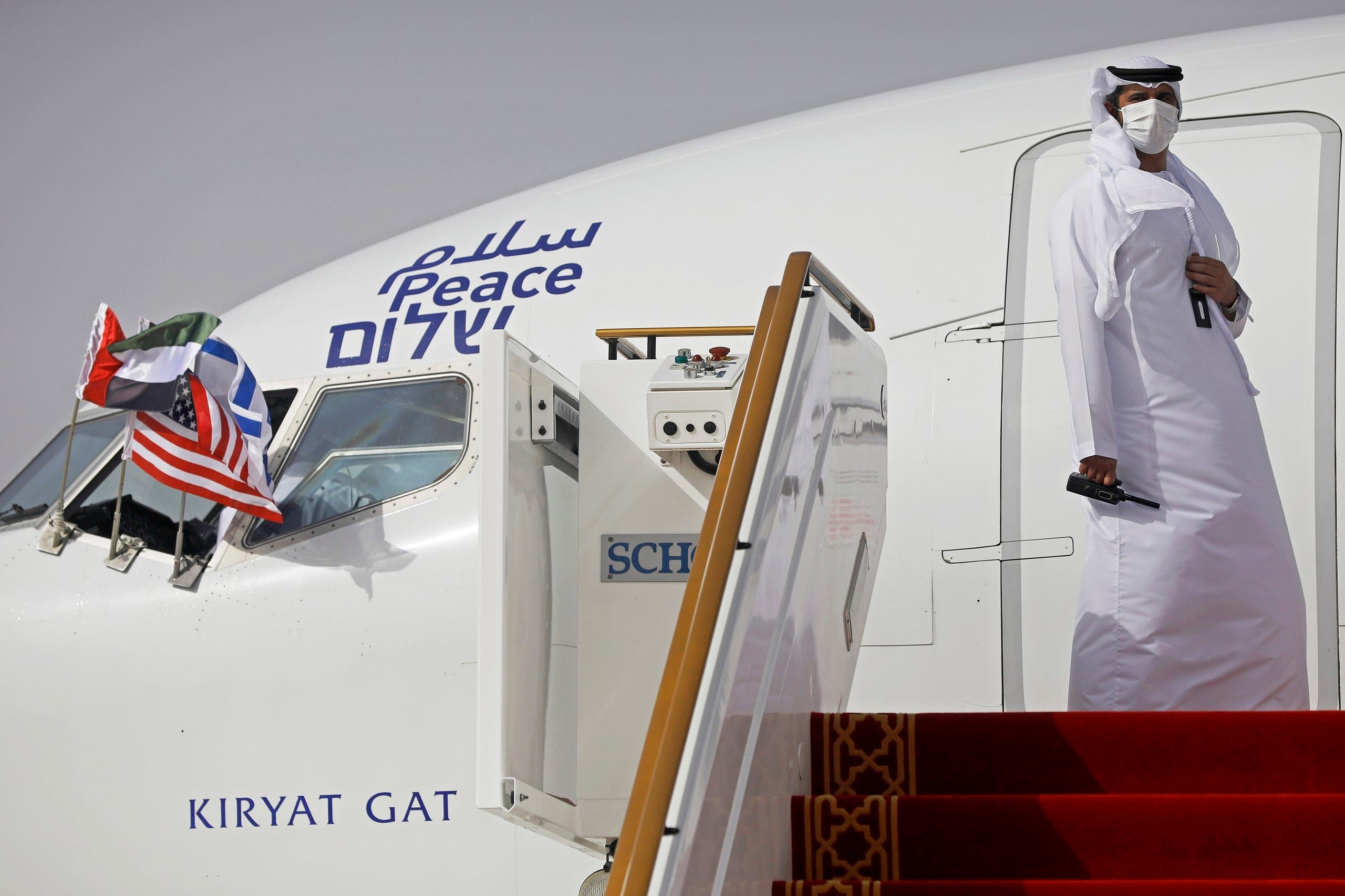 An official stands at the door of an Israeli El Al airliner after it landed in Abu Dhabi, United Arab Emirates on August 31, 2020. (AP)