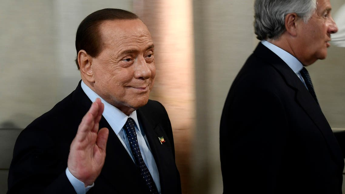 Former Italian PM Silvio Berlusconi (L) waves at the Quirinal presidential palace in Rome, on August 28, 2019. (AFP)