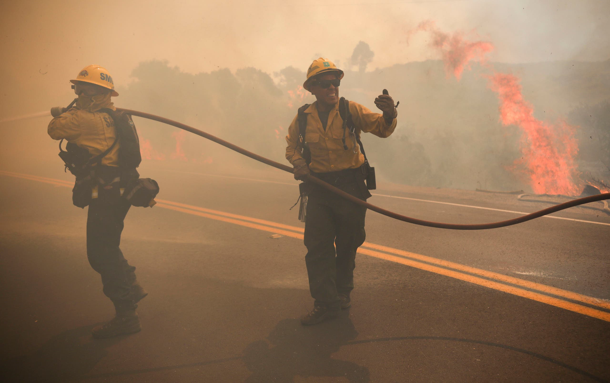 San Miguel County Firefighters battle a brush fire along Japatul Road during the Valley Fire in Jamul, California on September 6, 2020. (AFP)