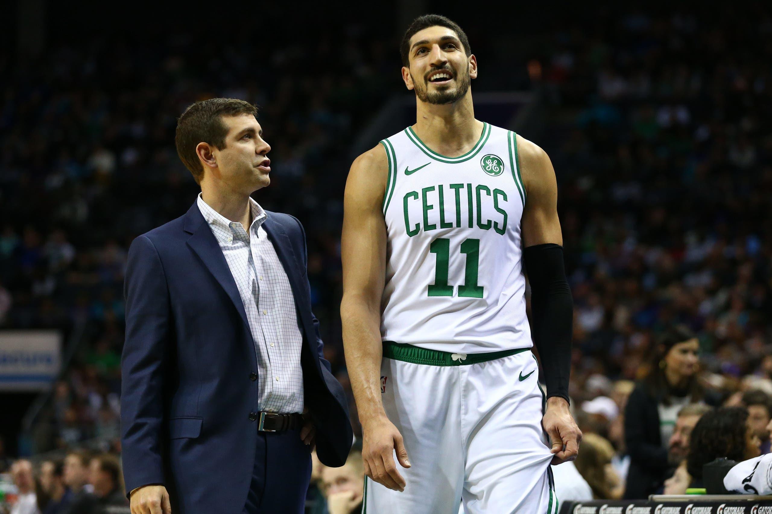 Boston Celtics center Enes Kanter talks with head coach Brad Stevens during the second half against the Charlotte Hornets at Spectrum Center. (Reuters)