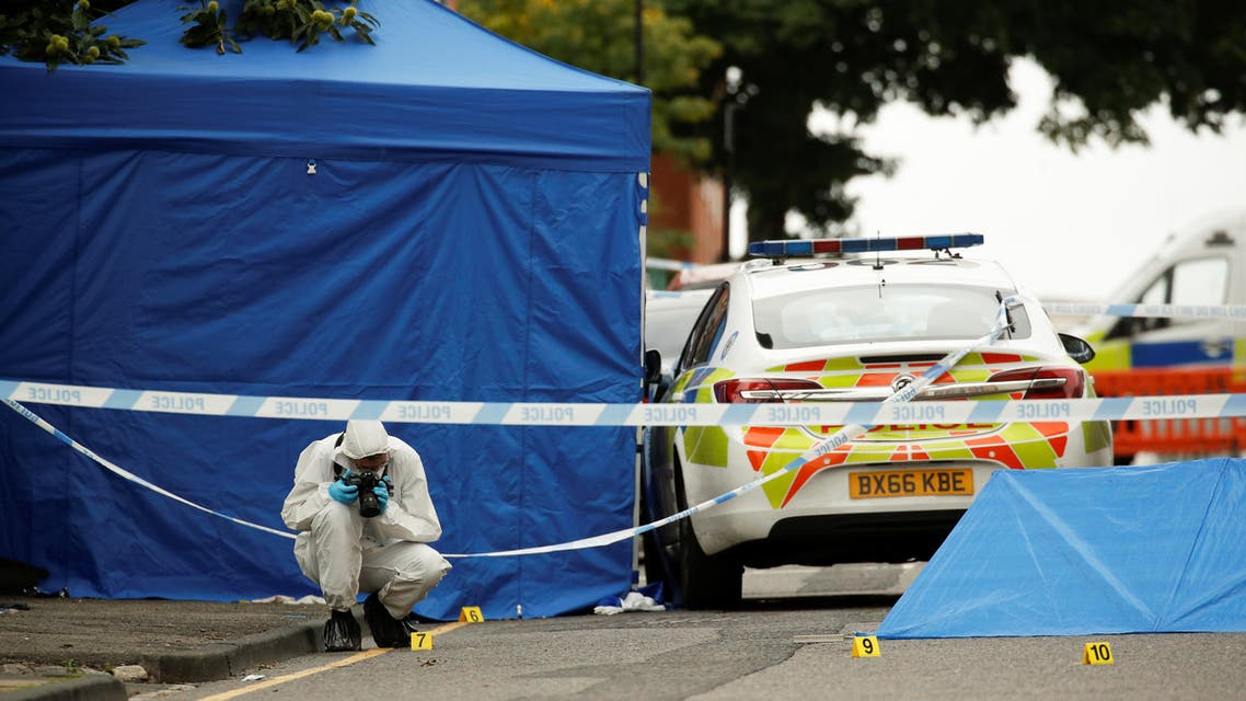 A forensic worker investigates at the scene of reported stabbings in Birmingham, Britain. (Reuters)