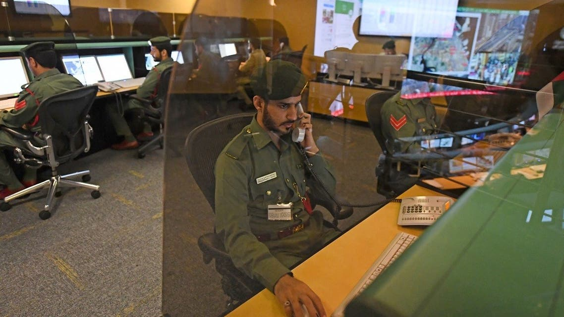 Police officers monitor the streets and receive calls from citizens at the Command and Control Center of Dubai Police in the Gulf emirate, on February 24, 2020. (AFP)