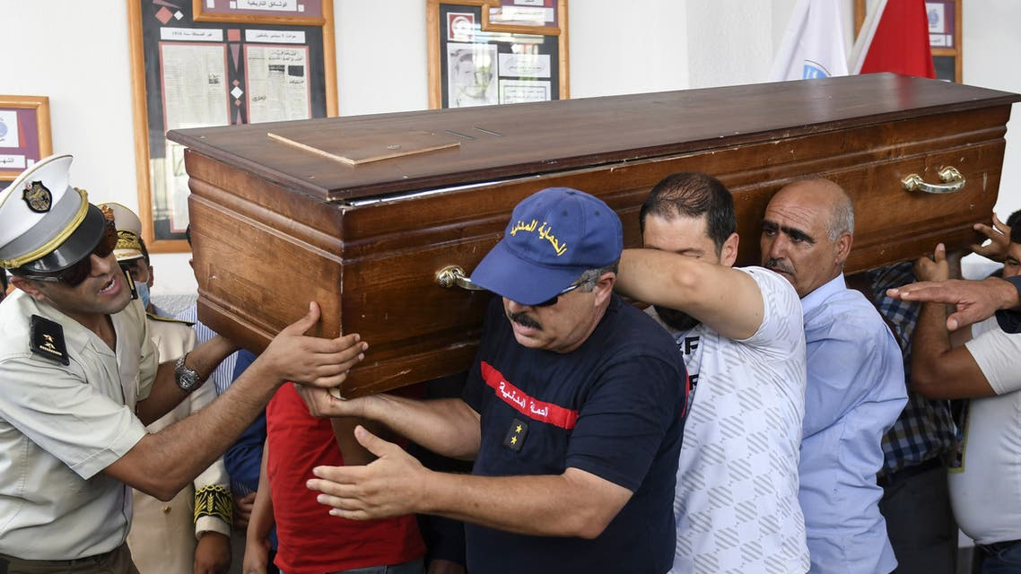 Members of the Tunisian National guard carry the coffin of a fellow officer during his funeral in the Moknine suburb of Sousse, on September 7, 2020, a day after he was killed in an attack on a touristic district of the coastal city. The Islamic State group claimed responsibility for a knife attack in Tunisia which killed one National Guard officer and wounded another, as security forces rounded up more suspects.
