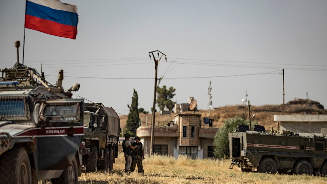 Russian soldiers reposition in the town of Derouna Arha near the Syrian border with Turkey on June 16, 2020.