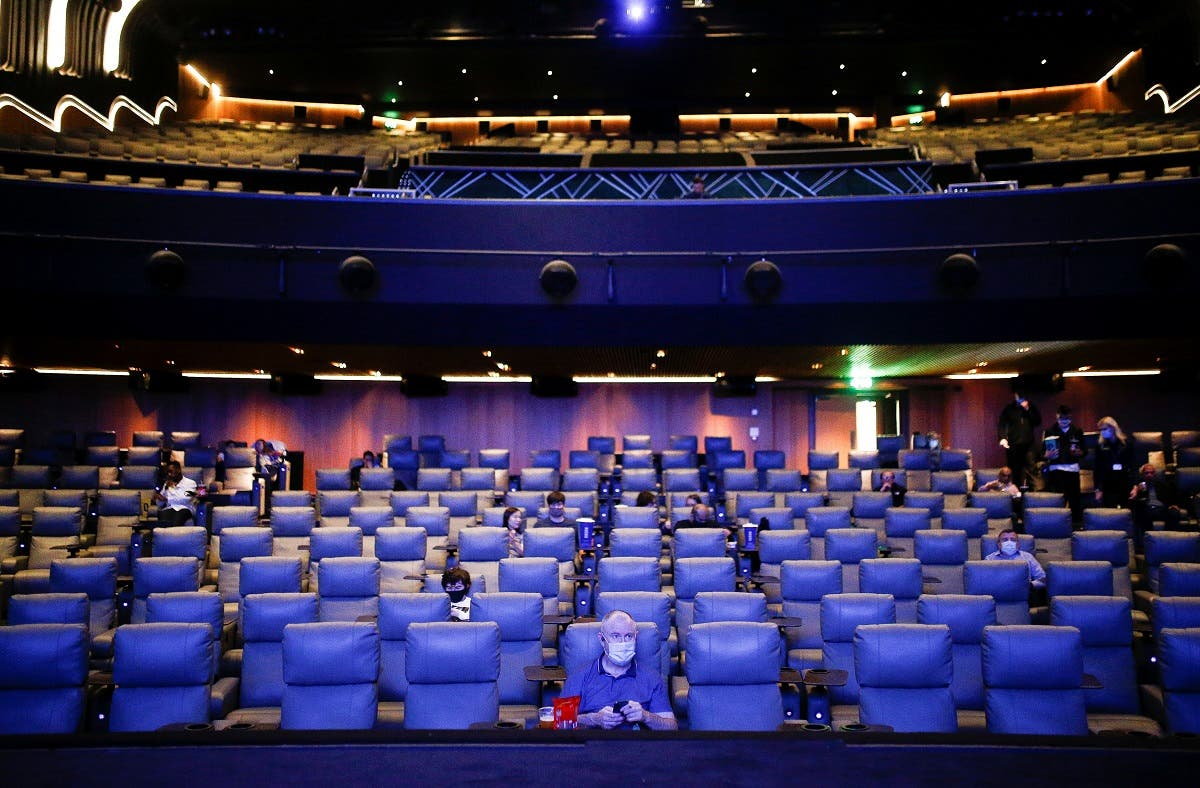 "People take their seats inside the Odeon Luxe Leicester Square cinema, on the opening day of the film ""Tenet"", London, UK, August 26, 2020. (Reuters)"