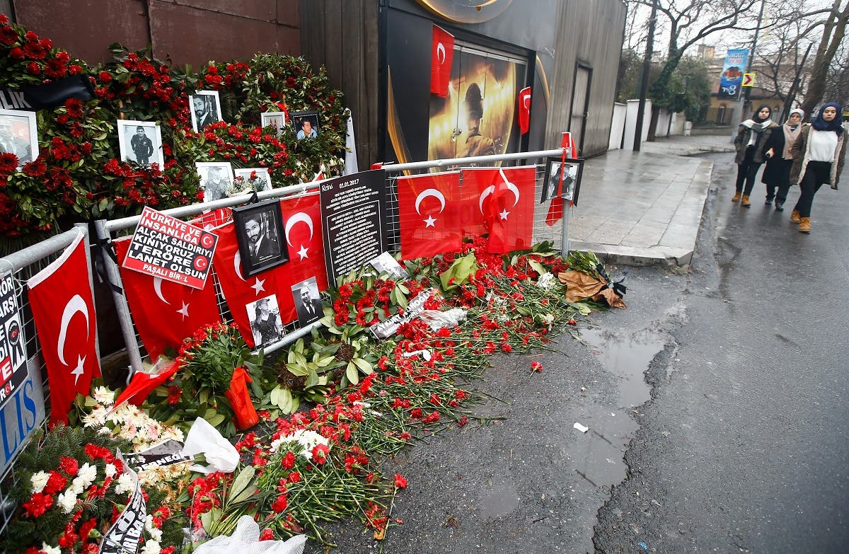 Flowers and pictures of the victims are placed near the entrance of Reina nightclub in Istanbul, Turkey, January 17, 2017. (Reuters)