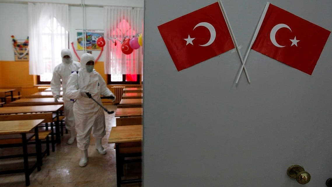 A cleaner from the Beyoglu municipality applies disinfectant to a classroom as a precaution taken in schools against the H1N1 virus at a primary school in Istanbul October 30, 2009. (Reuters/Murad Sezer)