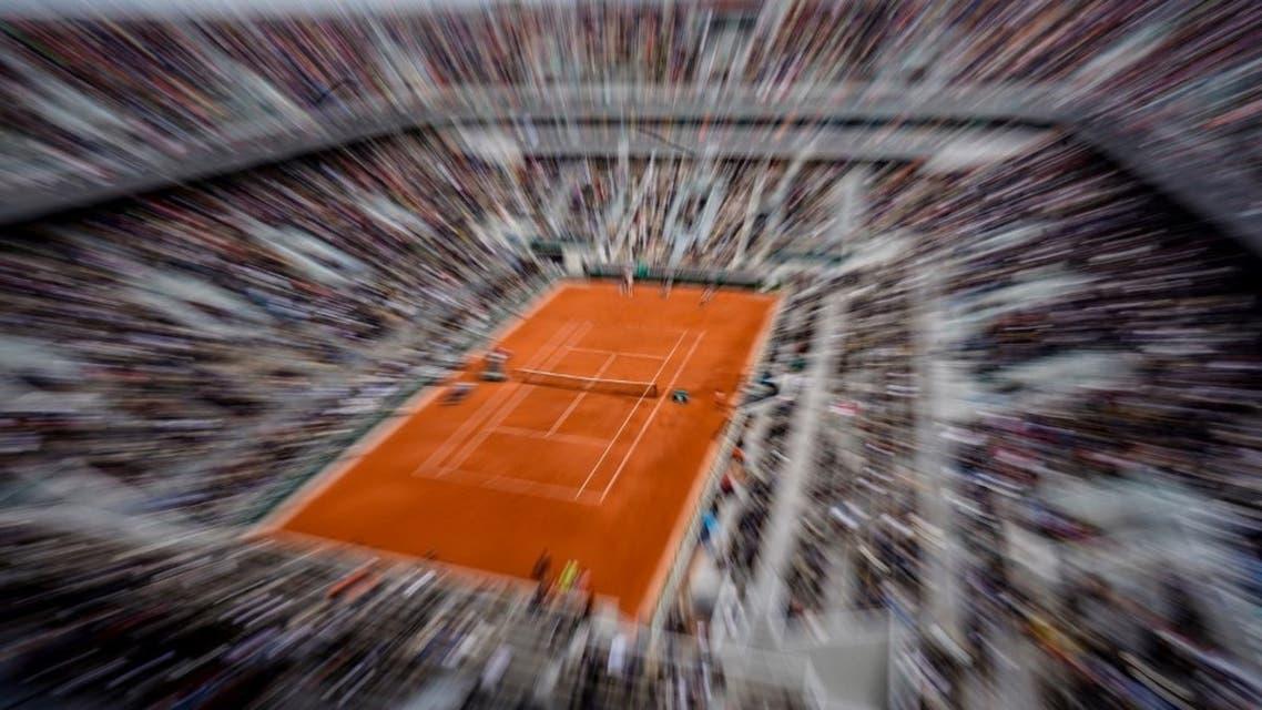 In this file photo taken on June 7, 2019, Spain's Rafael Nadal returns the ball to Switzerland's Roger Federer during their men's singles semi-final. (AFP)