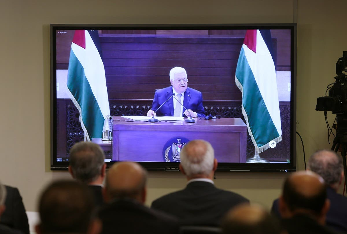 Palestinian President Mahmoud Abbas is seen on a screen during the Palestinian factions' meeting over Israel and the United Arab Emirates' deal to normalise ties, in Beirut, Lebanon. (Reuters)