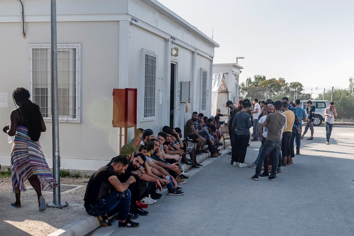 Syrian refugees rest inside the Temporary Accommodation Centre in Kokkinotrimithia, some 20 km outside the Cypriot capital Nicosia on November 5, 2019. (AFP)