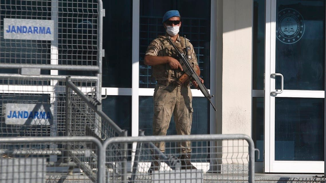 A Turkish soldier stands behind a barricaded entrance of the Silivri courthouse, in Silivri, outside Istanbul, Monday, Sept. 7, 2020, before the trial of AbdulkadirMasharipov. (AP)