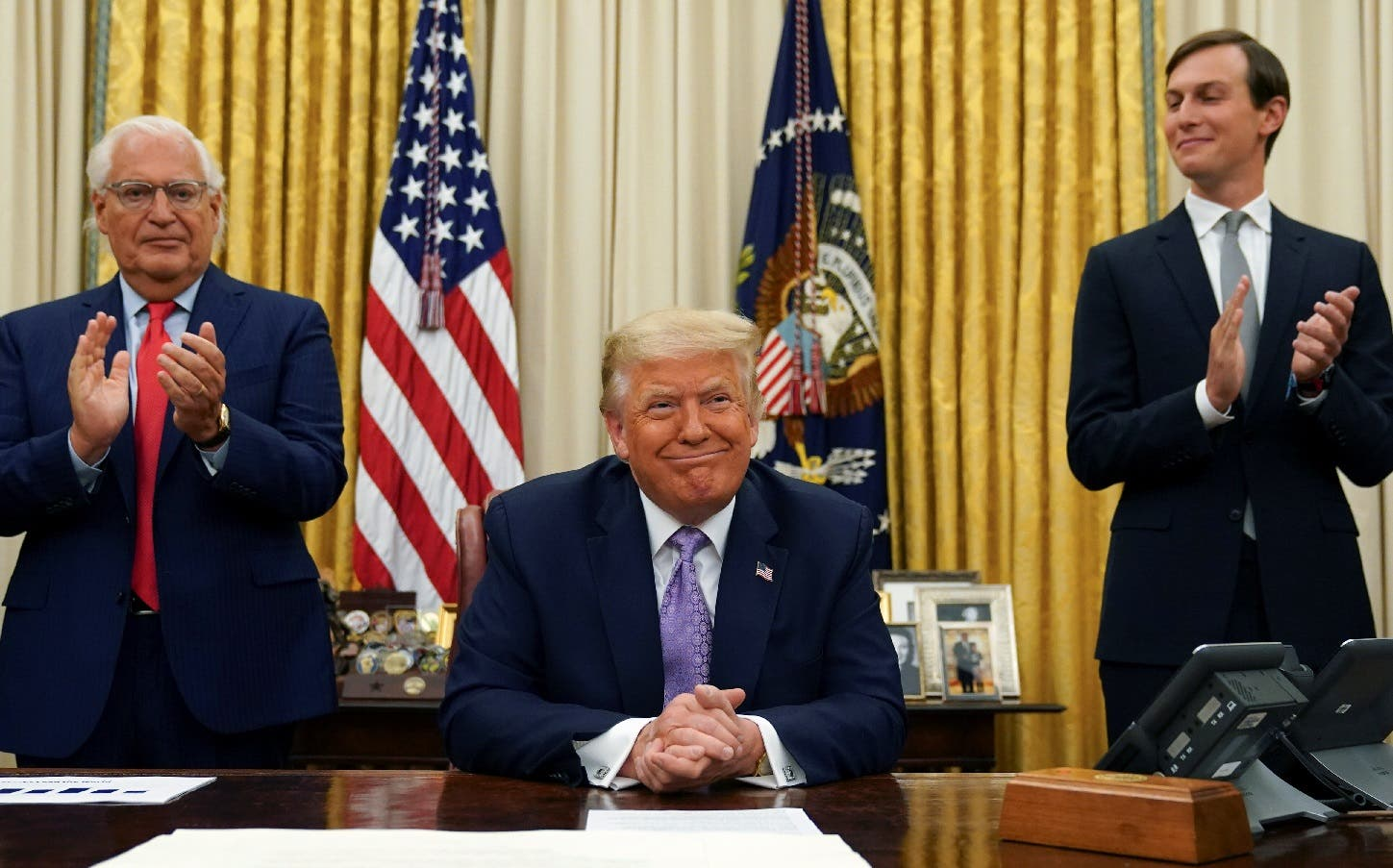 US Ambassador to Israel David Melech Friedman and White House senior adviser Jared Kushner applaud after US President Donald Trump announced a peace deal between Israel and the UAE from the Oval Office of the White House in Washington, US, August 13, 2020. (Reuters)