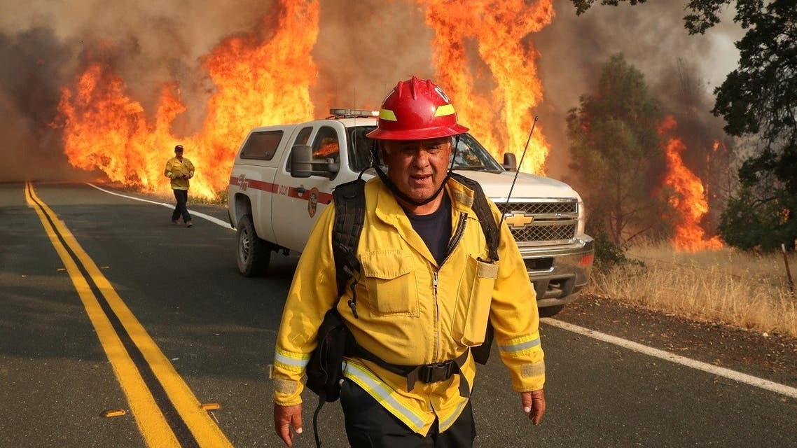 Chula Vista firefighter Rudy Diaz monitors the LNU Lightning Complex Fire as it engulfs brush in Lake County, California, US August 23, 2020. (Reuters)